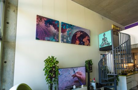 Hanging art on walls with high ceilings