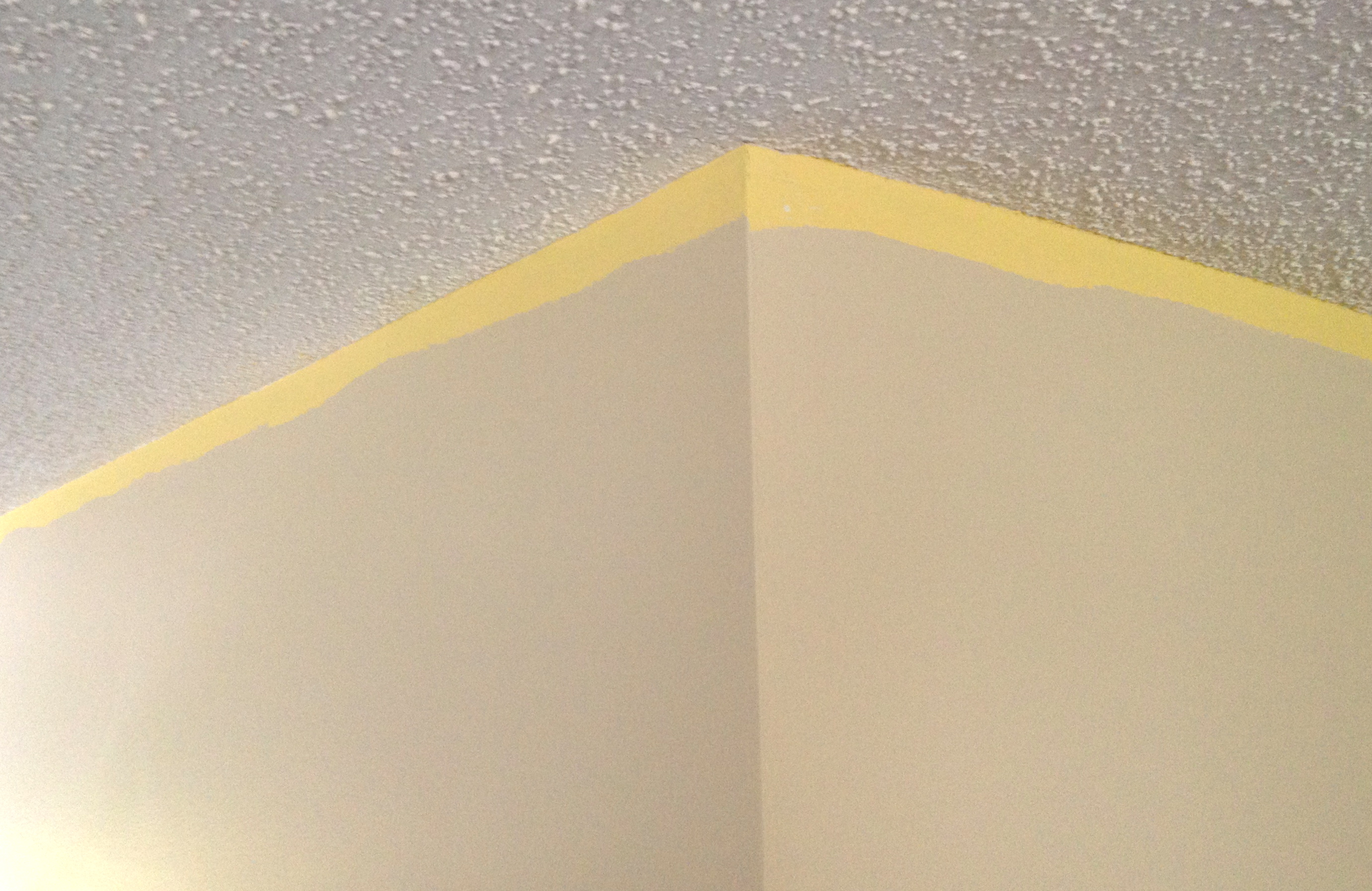 Unpainted top of wall to be covered by crown molding.