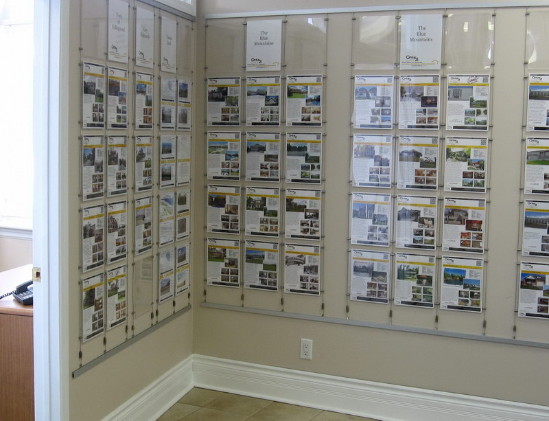 Century 21 Real Estate Showcase Display Using Letter Size Acrylic Pockets by AS Hanging Systems