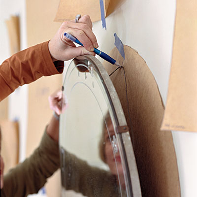 Southern Living Magazine showing using paper templates to hang art and wall objects