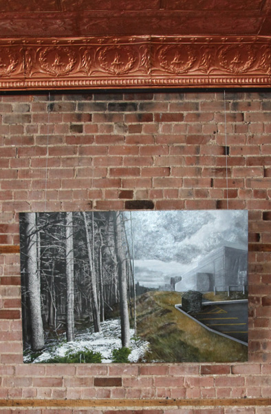Hanging art on a brick wall with AS Hanging Systems' Cable System.