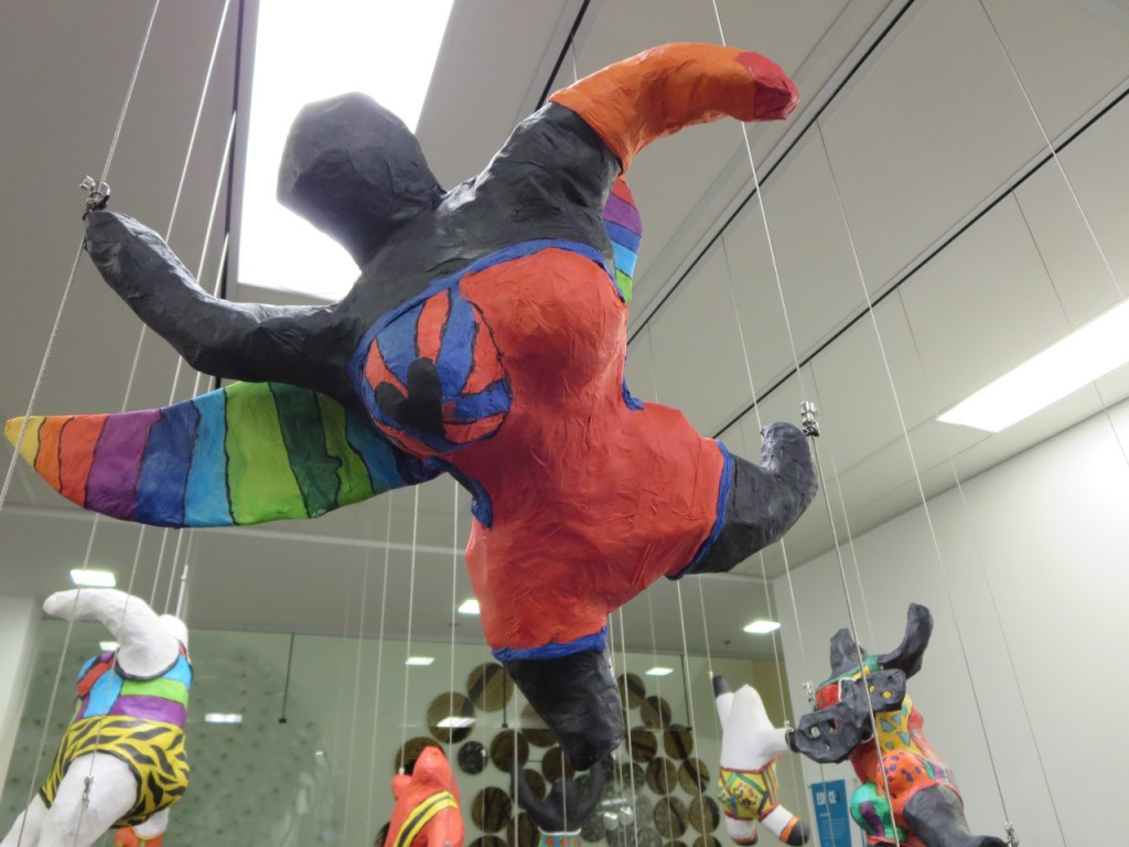 3D art floats mid-air using Mini Hooks on a tensioned cable system.