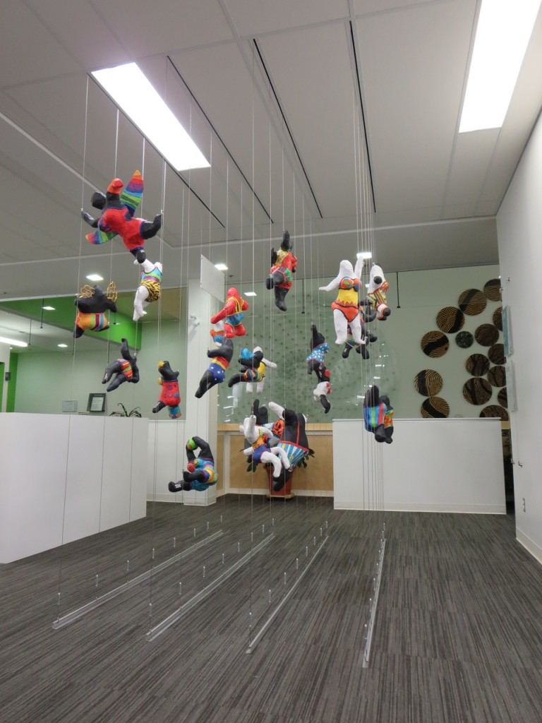 Floating art display created by using a Tensioned Cable System.