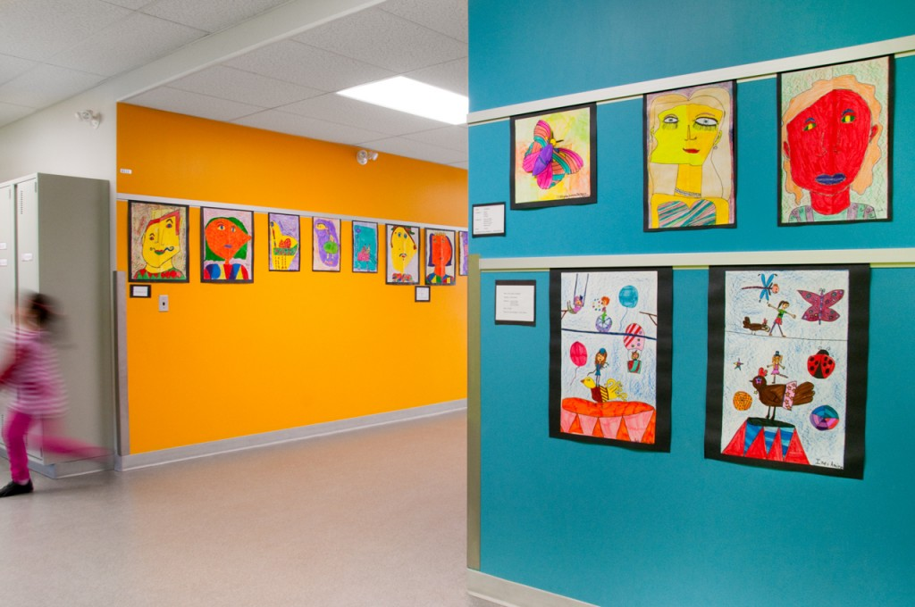 Casso® Display Rail displays school art better than bulletin bars.