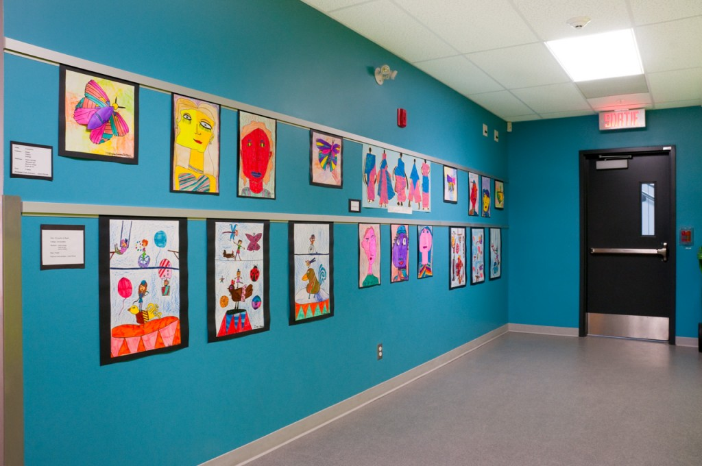 Casso® Display Rail used as bulletin bar for school art display.