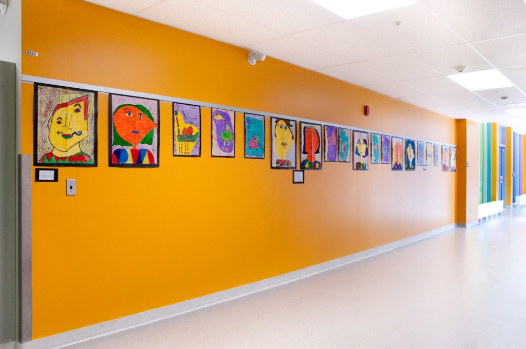 Casso® Display Rail substitutes for cork rail in school art display.