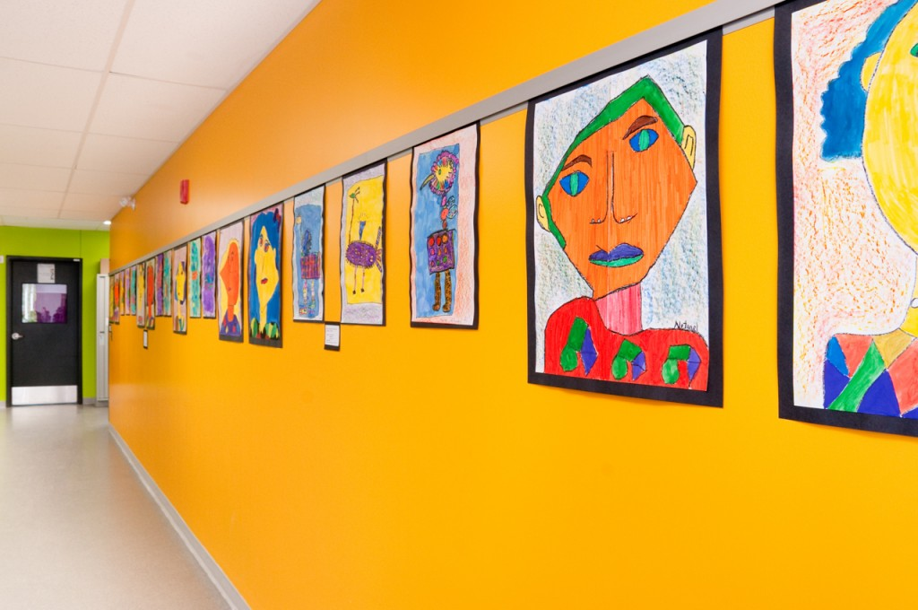 Casso® Display Rail replaces cork rail for school art display.