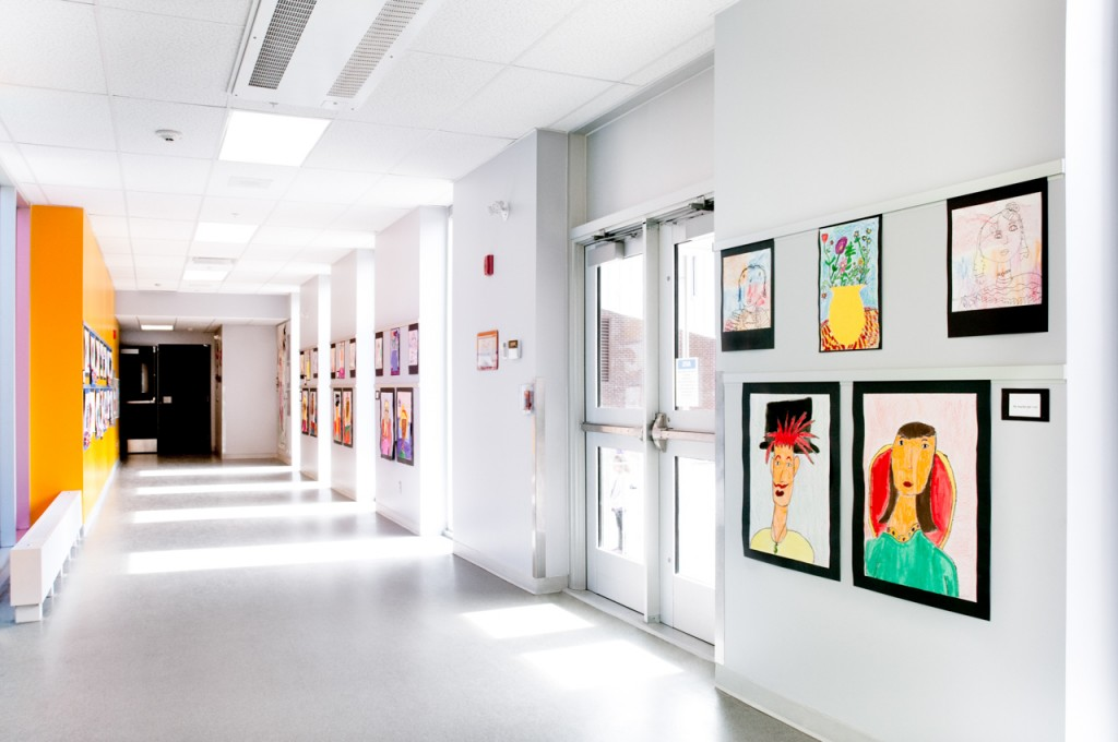 Casso® Display Rail creates safe school art display.