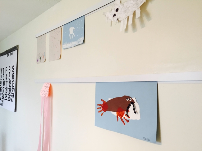Casso® Display Rail displays children's art without tape, sharps, push-pins, or magnets.