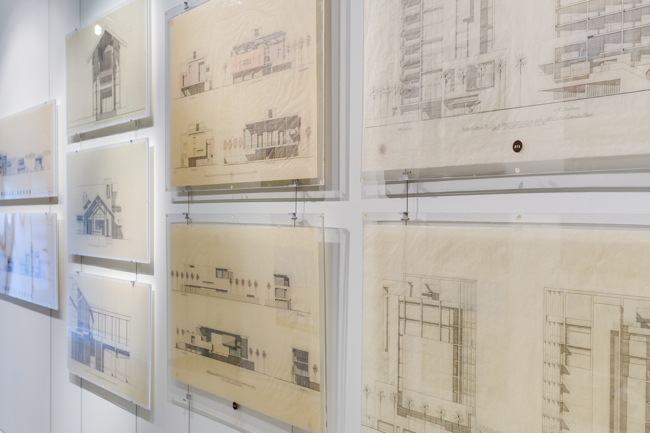 Vintage renderings sandwiched in acrylic by AS Hanging Display Systems.