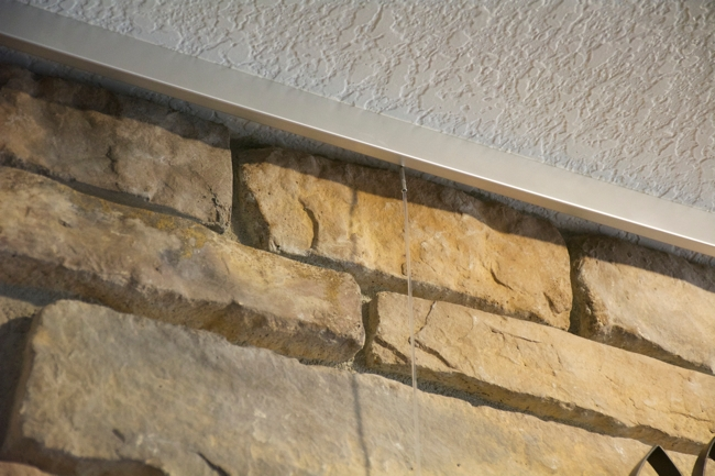 How To Hang Art on a Stone or Brick Fireplace