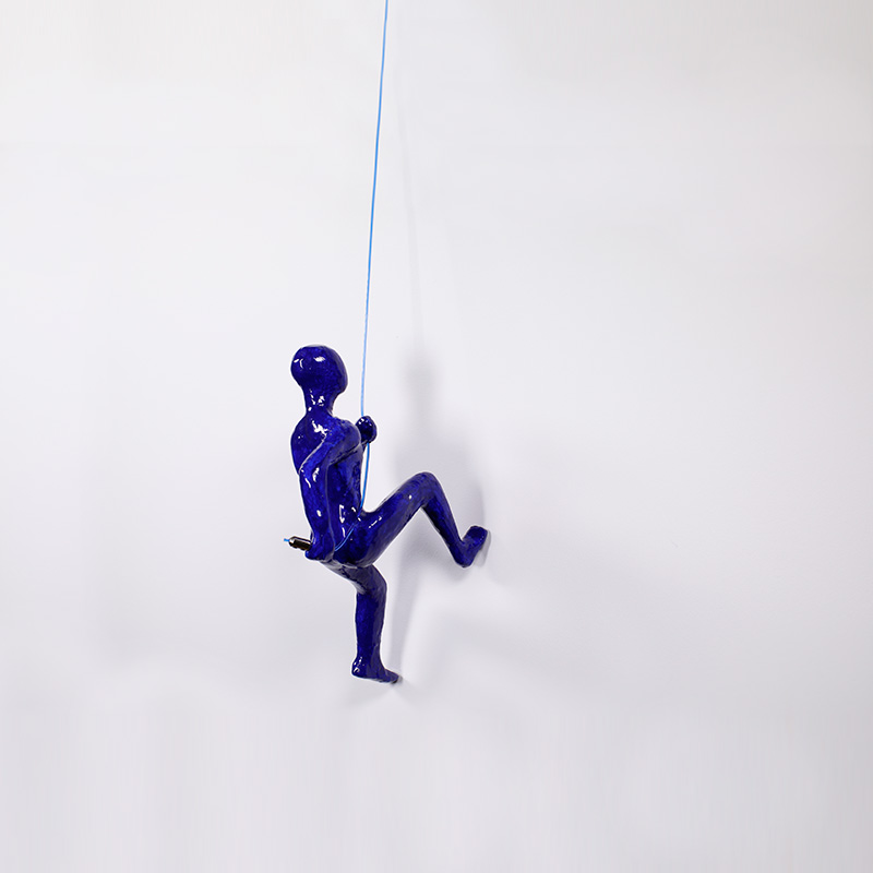 Wall Climber Sculpture suspended in AS Hanging System's Showroom