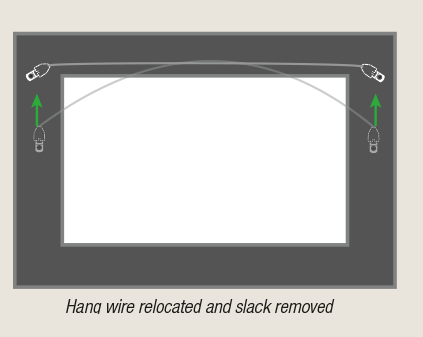 "Rear view of hang wire relocated and tightened to manage ""face forward"" frame tilt by AS Hanging Display Systems"