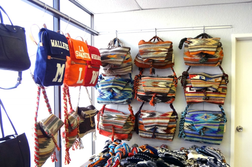 Various-sized Bags are Displayed Using Adjustable Cable System by AS Hanging Systems