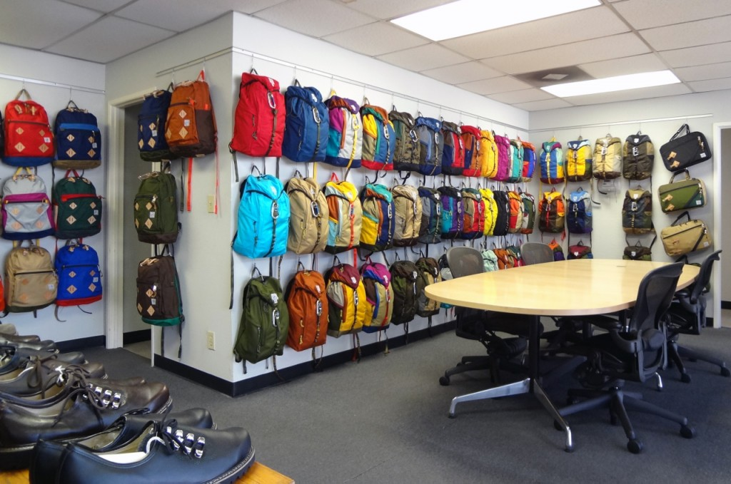 Retail Backpack Display Using Wall Track by AS Hanging Systems