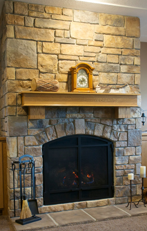 Stone fireplace with irregular surfaces. How to hang art?