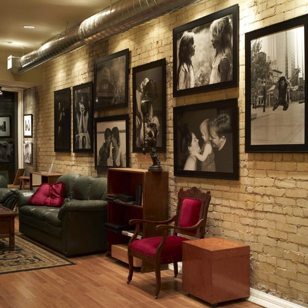 Photo Display on Brick Wall Using Cable System by AS Hanging Systems